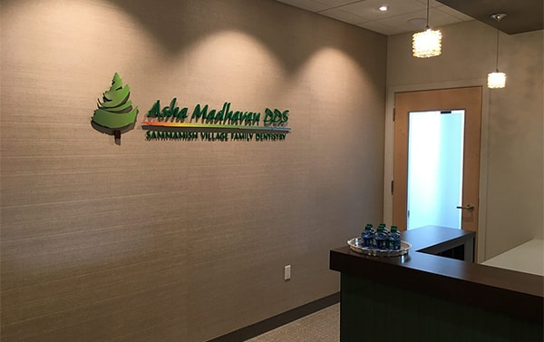Asha Madhavan's logo on the wall of the office