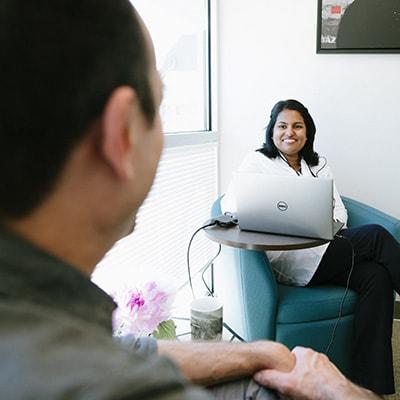 Dr. Asha Madhavan giving an Invisalign consultation at her Sammamish dental practice